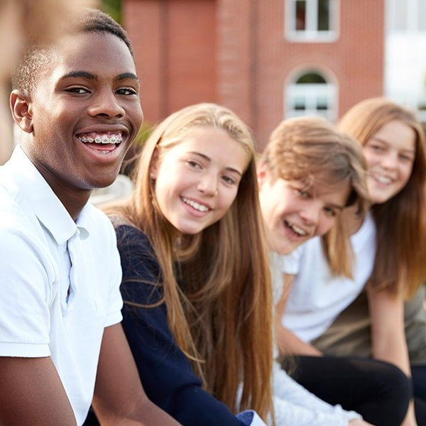 Group of culturally diverse teenagers with traditional braces