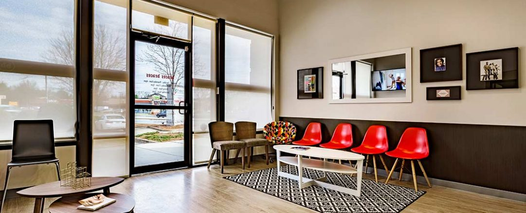 Bright and inviting orthodontic patient waiting room at Braces Braces in Marietta.
